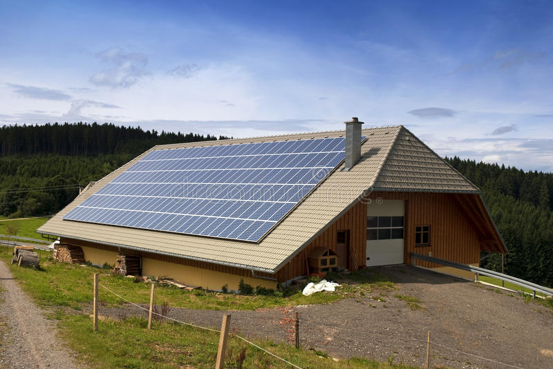 Solar panels. Farm roof with solar panels royalty free stock photography