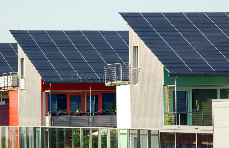 Solar Panels. On Different Colorful Houses stock photography