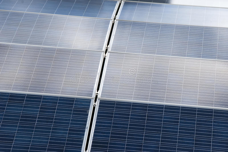 Solar panels. On a roof stock images