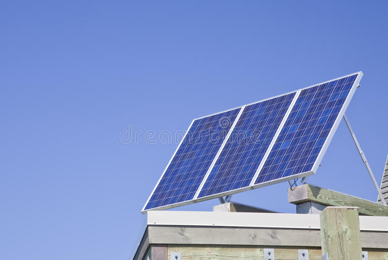 Solar panels. On top of a roof royalty free stock photography