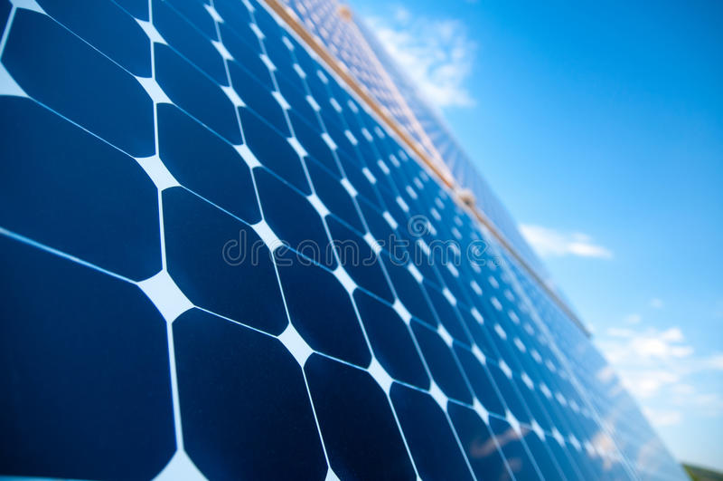 Solar Panels. Against The Deep Blue Sky stock image