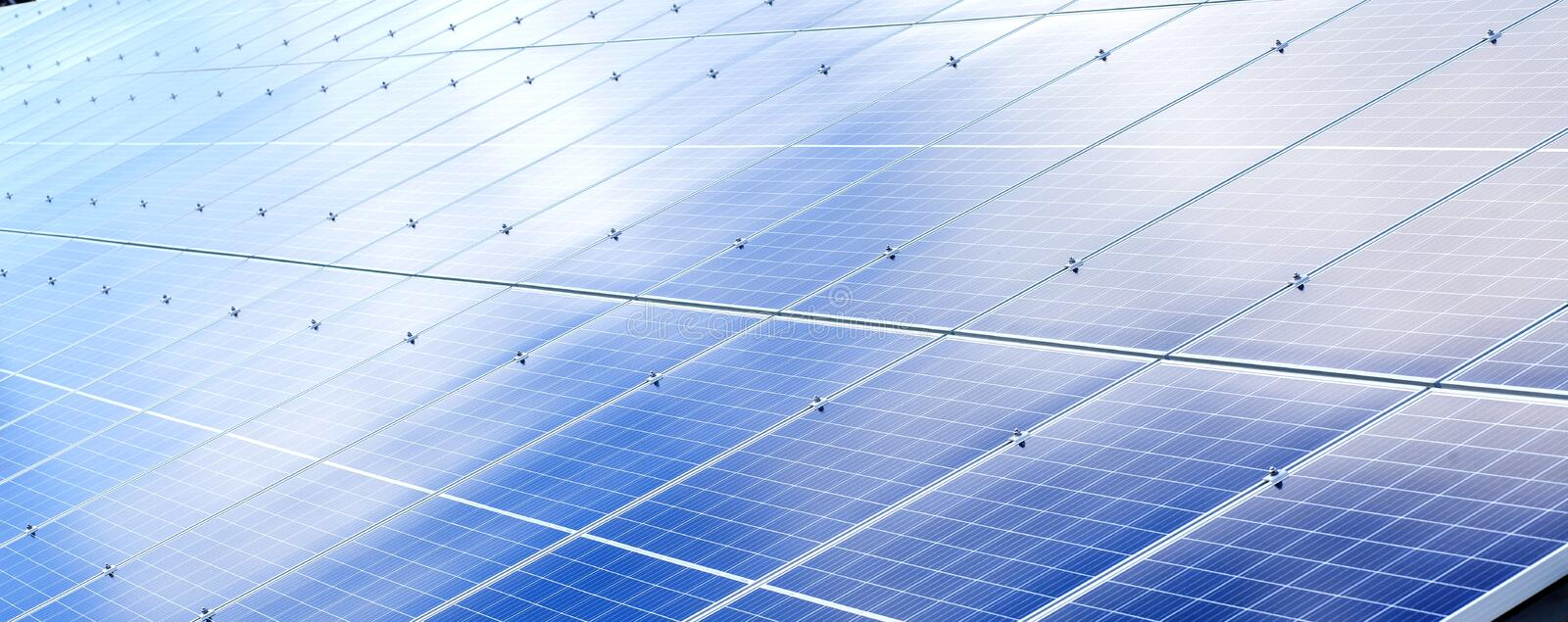 Solar panels background. Photovoltaic renewable energy source royalty free stock photography