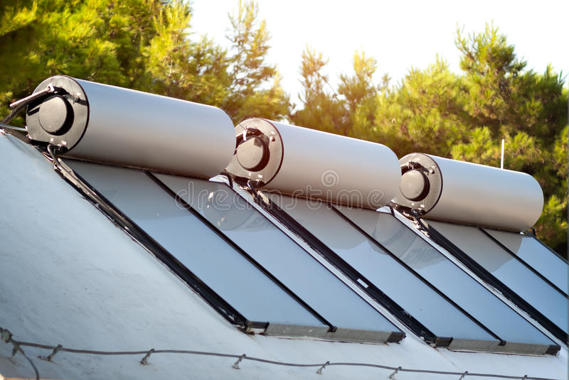 Solar panels and boilers for water heating. Solar panels and boilers for alternative water heating royalty free stock photos