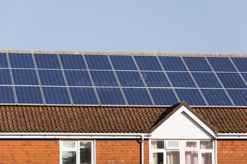 Download Solar Panels On Building Roof Stock Image - Image: 23609107