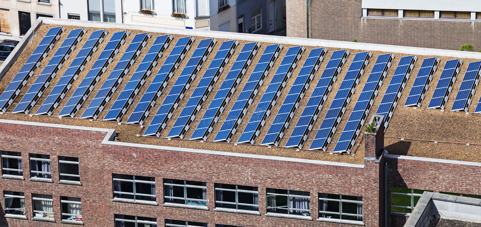 Solar panels on building roof royalty free stock photos