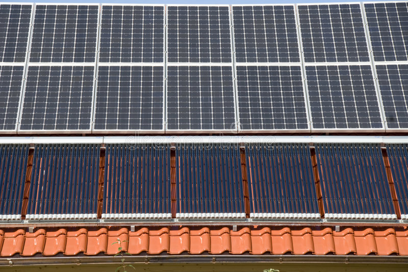 Solar panels and calefactors. Solar Collectors and heating device in a modern ecological house royalty free stock photos