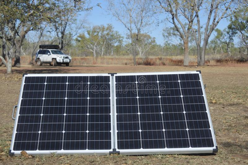 Solar panels charging equipment of a 4WD vehicle royalty free stock image