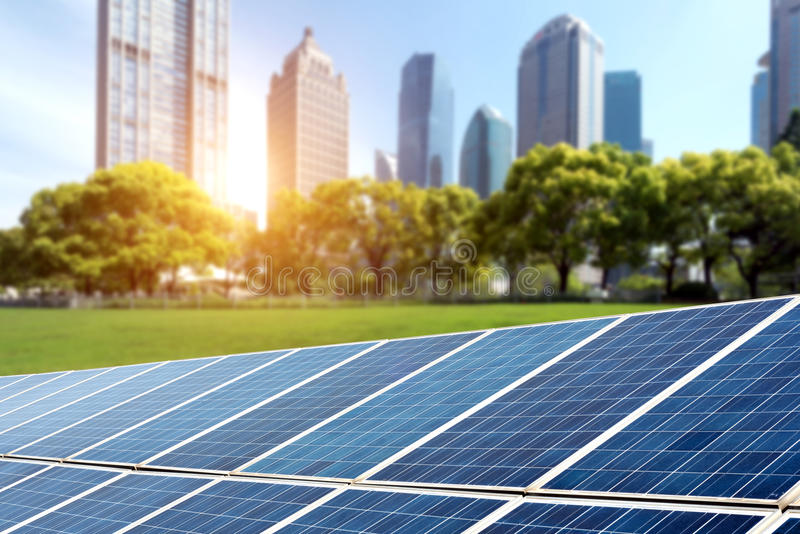 Solar panels cities stock images