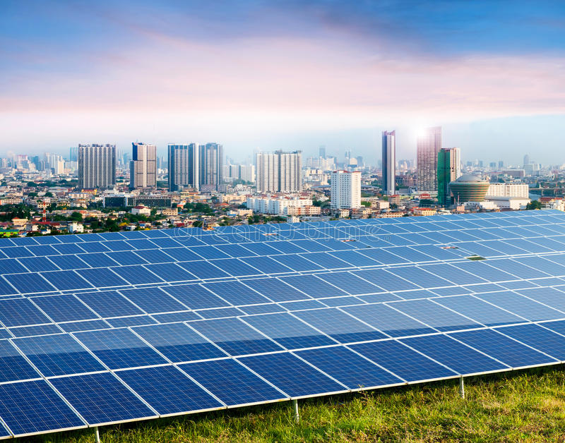 Solar panels, cityscape on background stock images