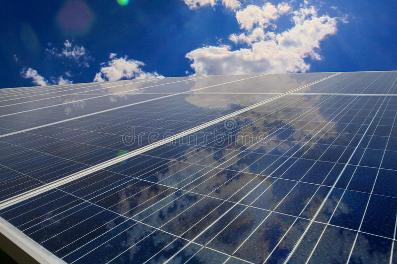 Solar panels with cloud reflection stock photos
