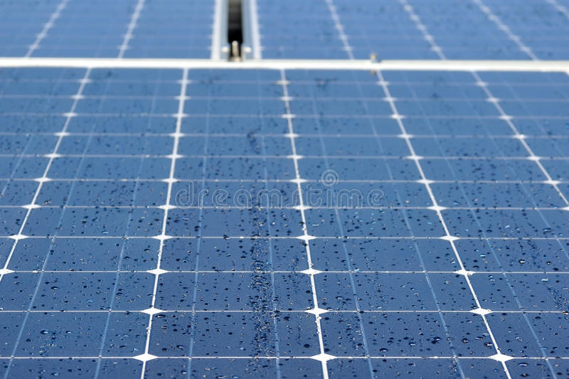 Solar panels in dew. Morning dew drops on solar panel cells, background royalty free stock photos