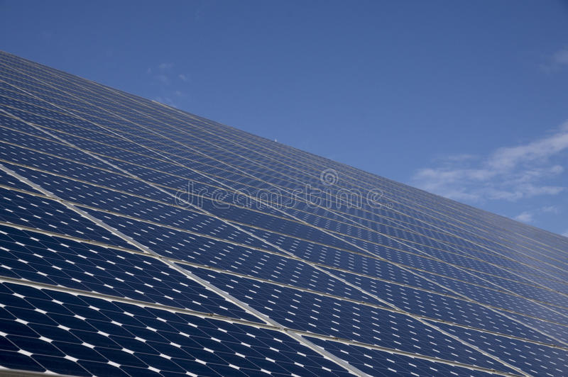 Solar panels for energy saving with blue sky behind royalty free stock photo
