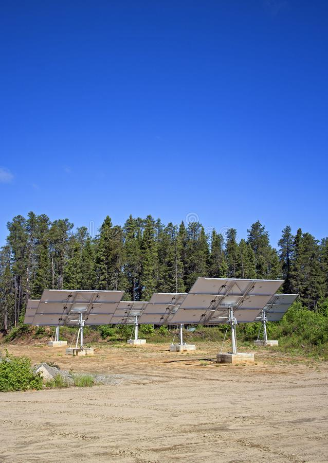 Forest alternative energy. Solar panels facing the sky in wild northern canadian forest royalty free stock photography