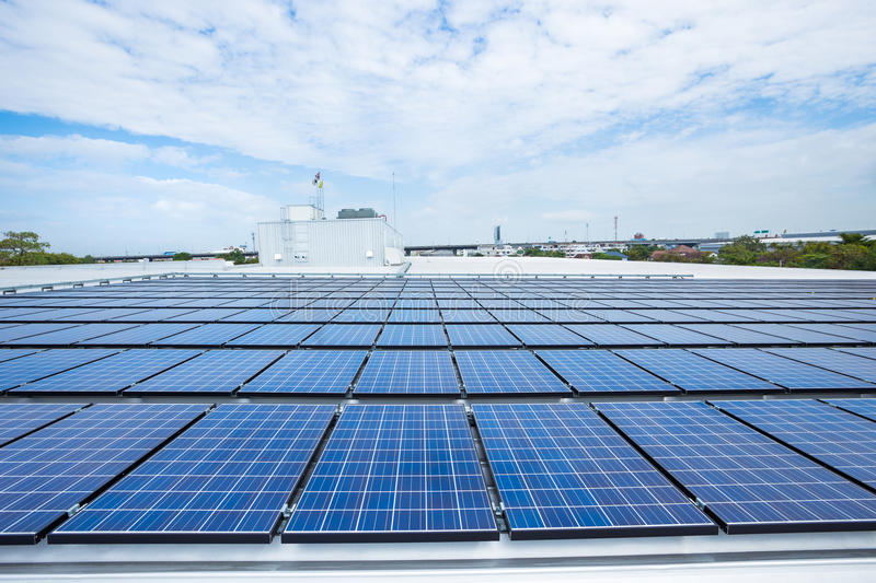Solar panels on factory roof stock images