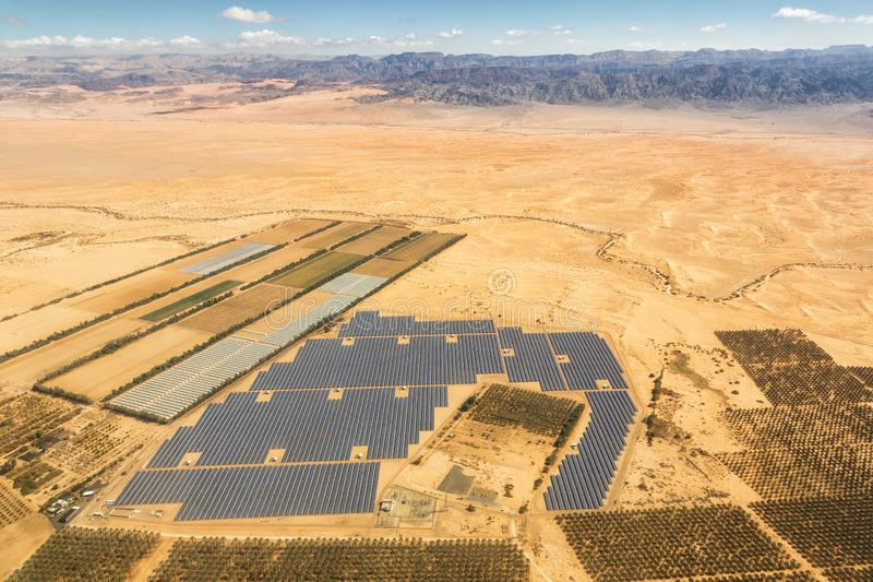 Solar panels farm energy panel Israel desert mountains from above aerial view. Landscape royalty free stock images