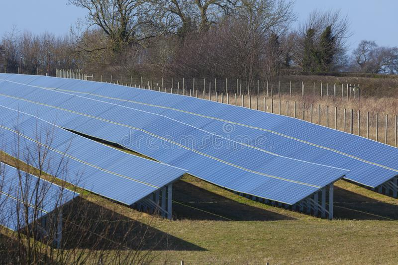Solar panels farm photovoltaic modules. NORFOLK UK, FEB 2019: Solar panels farm photovoltaic modules installed in a large area for commercial green energy supply stock image