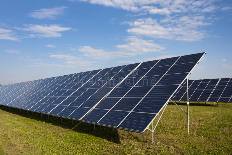 Solar panels. In a field stock photography
