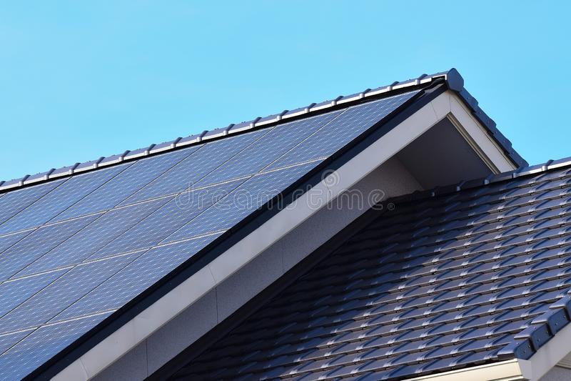 Solar panels fitted on modern house roof stock photo