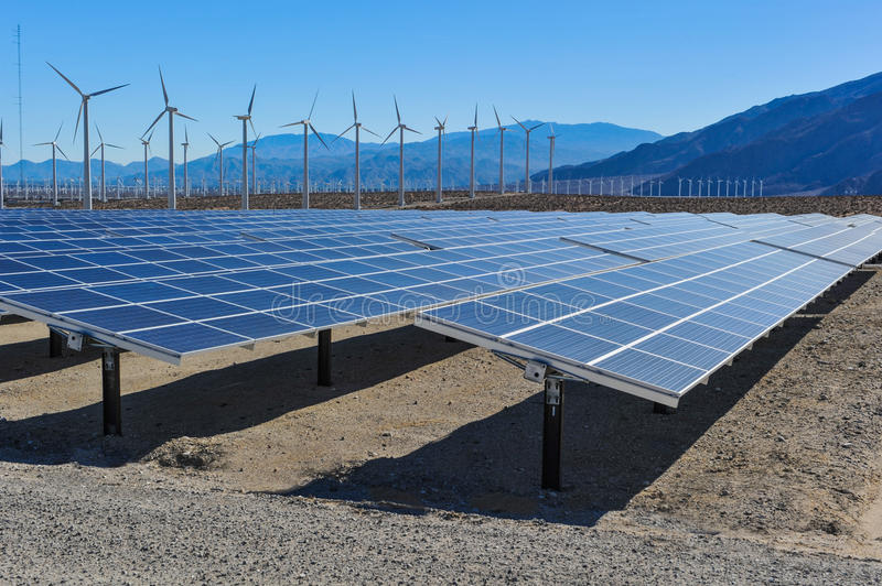 Download Solar Panels In Front Of Wind Turbines And Mountians Stock Photo - Image: 36707178