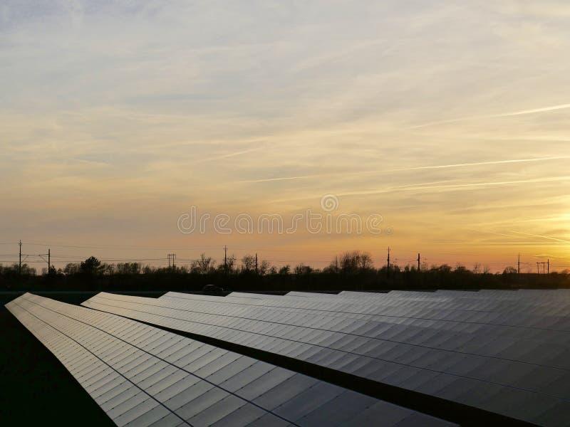 Solar panels. Generating power in the sunrise stock image