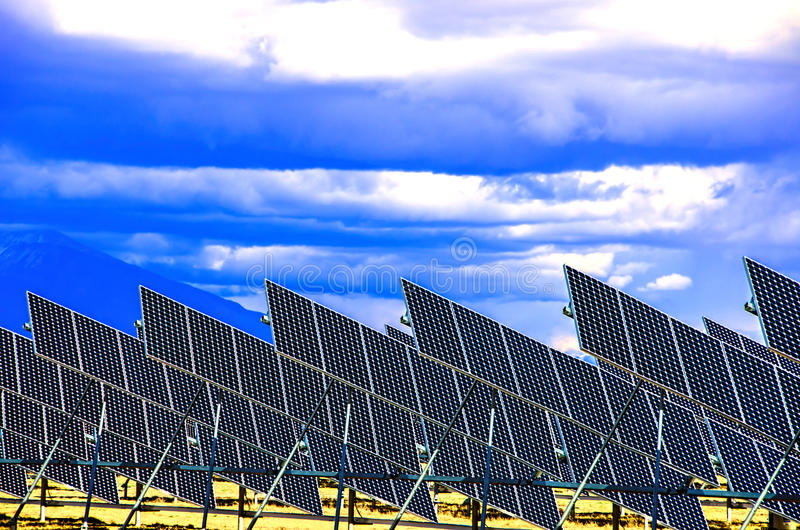 Solar panels. A group of solar panels with the Colorado mountains in the background royalty free stock image