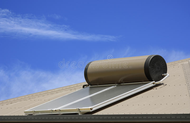 Solar panels for hot water. Solar panels used to heat water on a roof stock photos