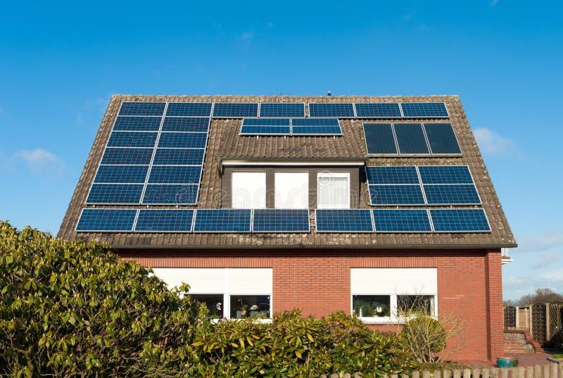 Solar panels on house stock photos