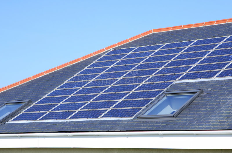 Solar Panels House Roof. Roof-mounted solar panels on a domestic house stock photo