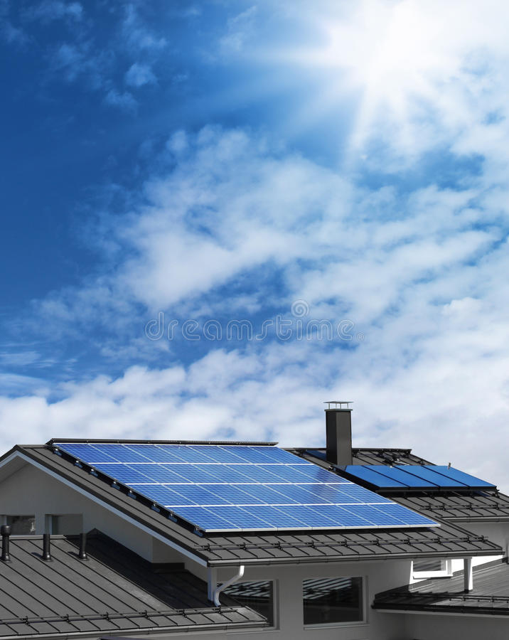 Solar panels on house rooftop. Solar panel system on house roof, sunny blue sky background royalty free stock photos
