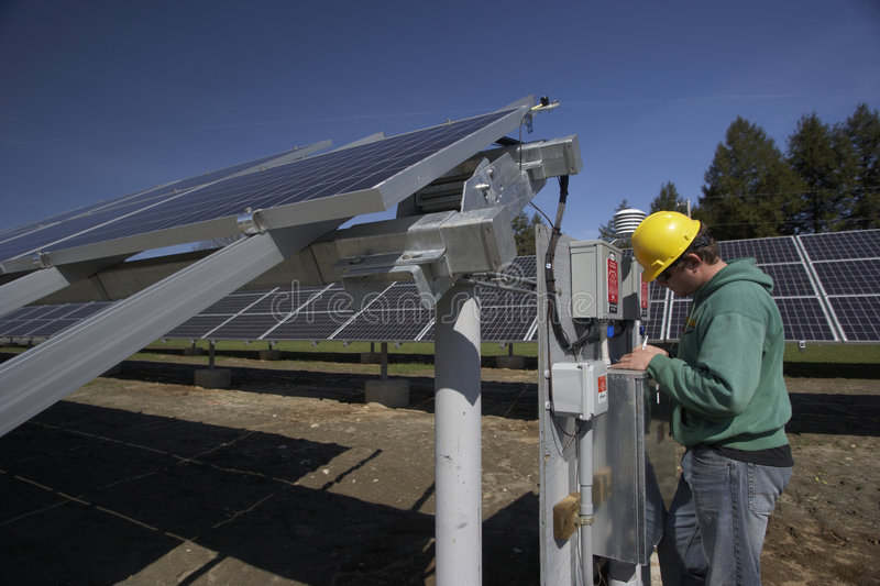 Solar Panels Inspected By Workman Stock Photography