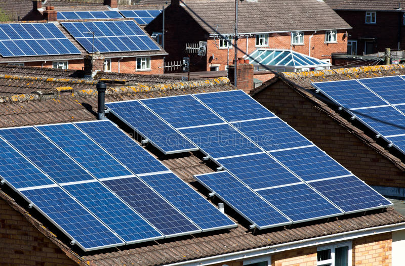 Solar Panels on many residential roofs stock photo