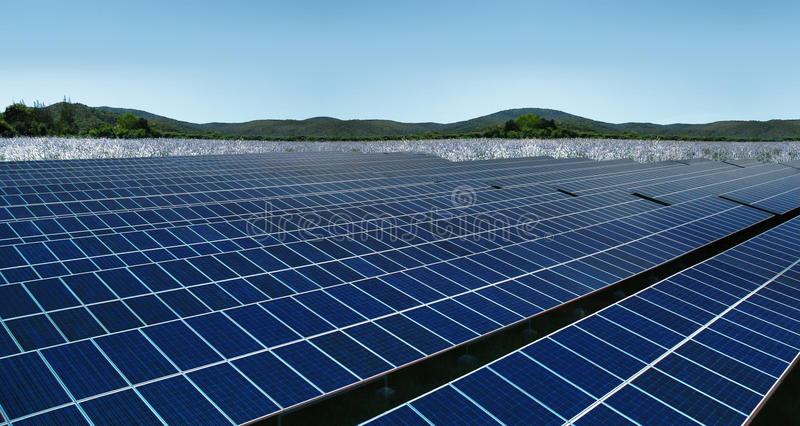 Solar panels on meadow hills landscape royalty free stock photos