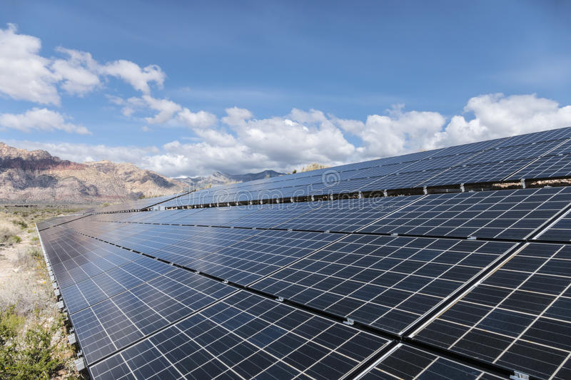 Solar Panels with Mojave Desert Backdrop royalty free stock images