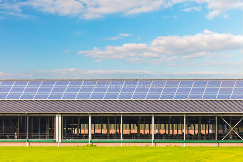 Solar panels on a new farm barn royalty free stock images