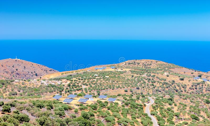 Solar panels in olive grove. Crete. Greece stock image