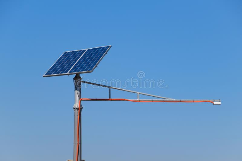 Solar panels on a pole to power a traffic light royalty free stock photo