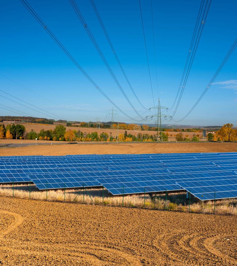 Download Solar Panels And Power Lines Stock Image - Image: 32215831