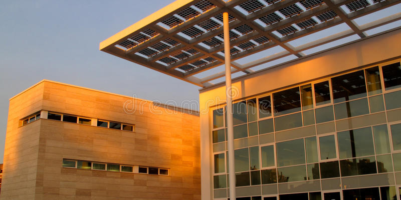 Solar panels in public building. Public building with solar cells in the city of segrate, lombardy, italy stock image
