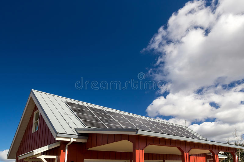 Solar Panels on Red House Rooftop stock photos