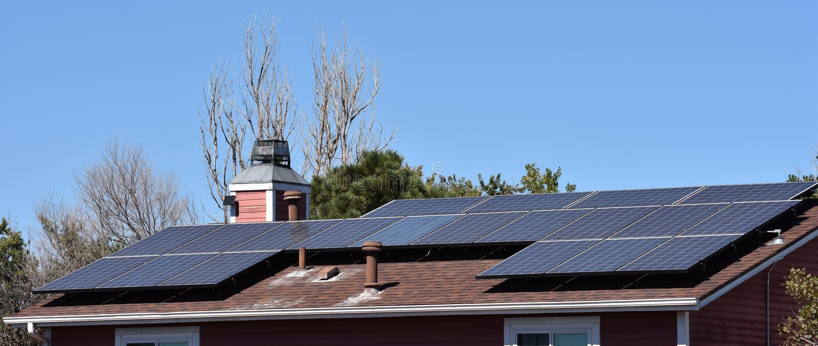 Solar Panels on Residence. Solar panels providing self sufficient energy and a green choice on a home in the Denver suburbs stock image