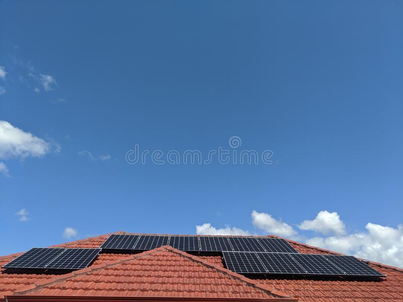 Solar Panels on a Residential House. Renewable, energy, domestic, sky, roof, tiles, electricity, sustainable, sustainability, green, clean, home, generating royalty free stock photos