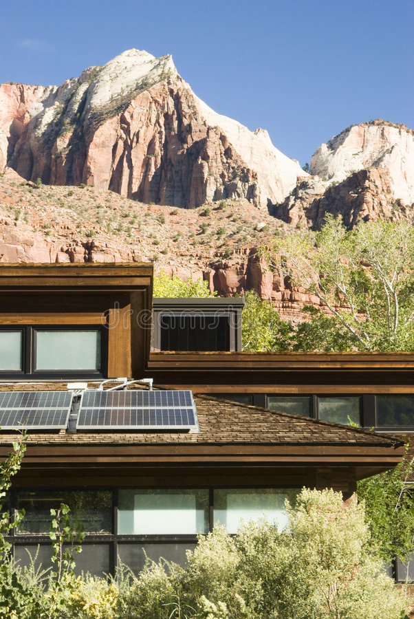 Solar panels on roof 2. Solar panels attached to the roof of the visitor's center in Zion National Park in southwest Utah. Sandstone formations in the background stock photos