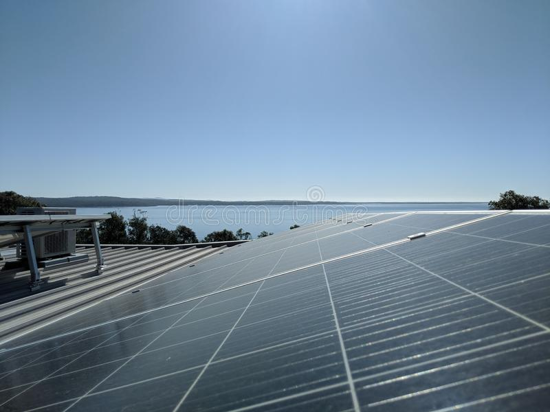 Solar Panels On A Roof Generating Clean Renewable Energy. Eco stock image