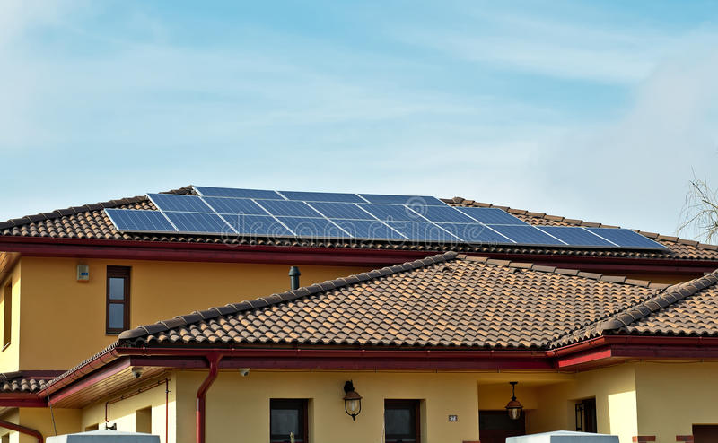 Solar panels on a roof of a house. For saving energy royalty free stock photo