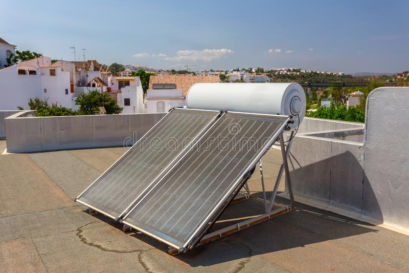 Solar panels on the roof of the house, for heating water. stock photography