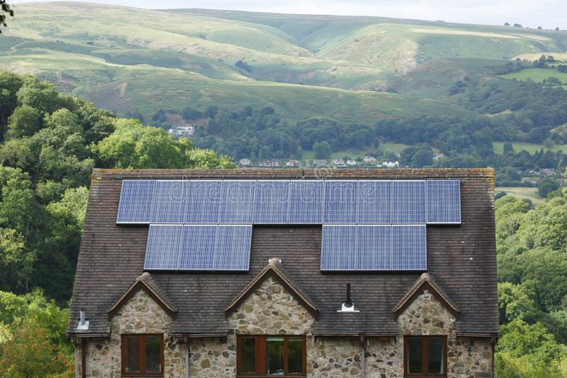 Solar panels on roof of house UK royalty free stock image