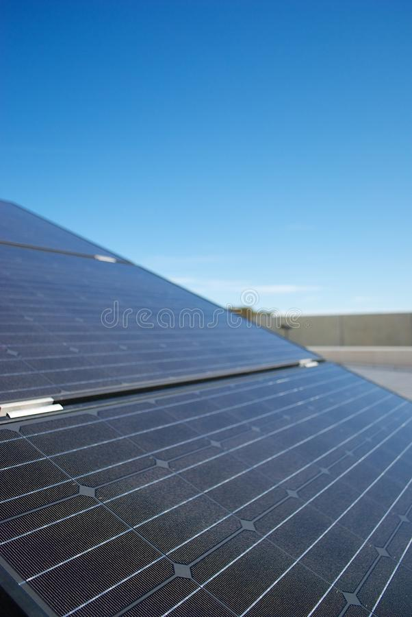 Solar panels on a roof. Solar panel (Photovoltaic panels) on an industrial roof. Blue sky on the background royalty free stock images