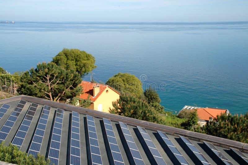 Solar panels and sea in Bergeggi, Italian Riviera royalty free stock images