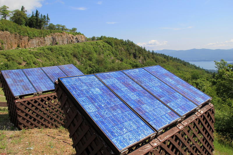 Solar Panels On The Side Of A Scenic Mountain Stock Photo