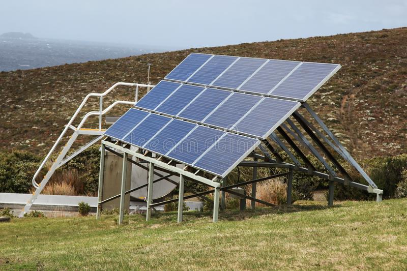 Solar panels situated on a hill. Harnessing free power from the sun stock images